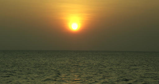 Beautiful sunset at the beach - Scene of a golden sunset on the sea Footage
