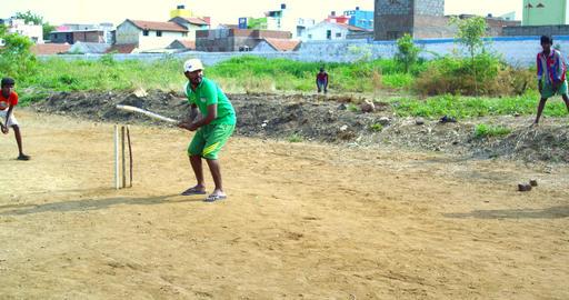 Indian teenage boys play cricket Footage
