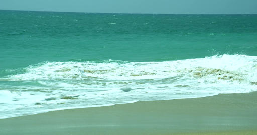 Ocean Waves and Beach, accumulating clouds over waves touching sandy beach Footage