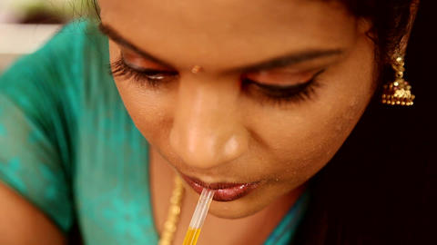 woman drinking drink juice through a straw Stock Video Footage