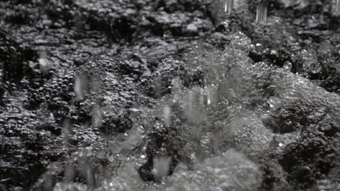 Rain falling splashing on water slow motion Archivo