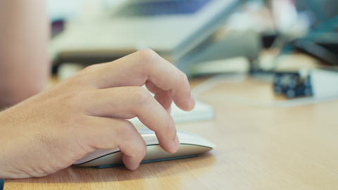 man hand working with wireless mouse on a desk ビデオ