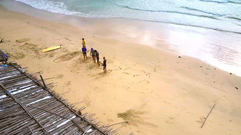 surfer beginners train on sand beach against ocean Footage