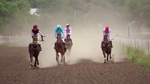 Four Riders on Horse Races. Slow Motion Footage