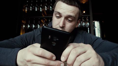 Man concentrating on using smartphone Footage