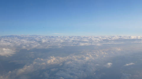 view of a sea of cloud from the porthole of a liner airplane Footage