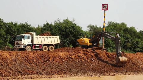 Excavator operation near riverbank of Tonle Sap lake in Cambodia Footage