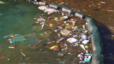 Garbage floats in the sea near the coast. Abuse of environment Footage