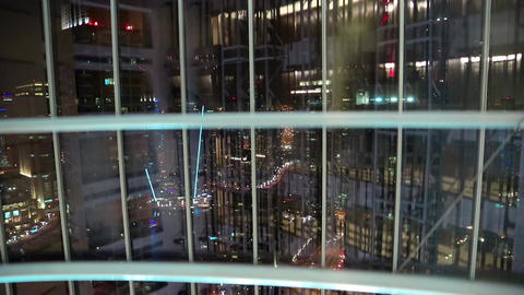 View from glass elevator at night, Dubai, United Arab Emirates. Lift goes down Footage