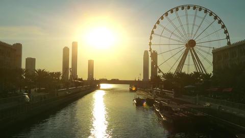 Al Qasba canal and ferris wheel in Sharjah city, United Arab Emirates Footage