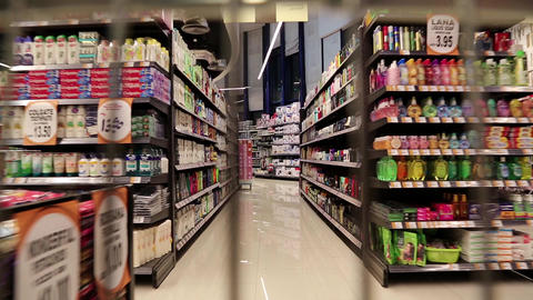 Counters with goods in a supermarket. View from the moving shopping trolley Footage