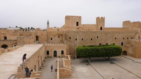 Monastir, Tunisia - 07 June 2018: Tourist people walking on territory ancient Archivo
