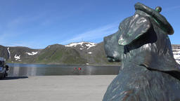 Europe Norway Honningsvåg at North Cape statue of a dog looks over the bay ビデオ