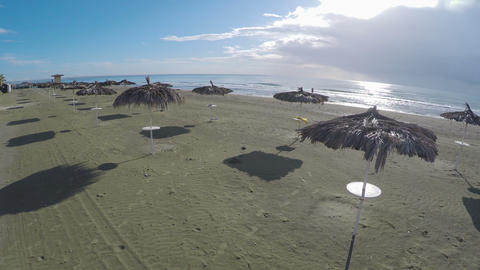 Resort city in Larnaca, aerial view on straw parasols standing on the beach ビデオ