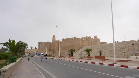 Monastir, Tunisia - 07 June 2018: People walking on city street on background Footage