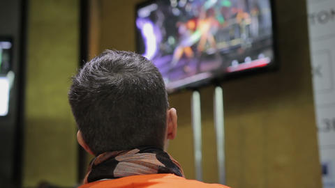 Man playing popular video game and looking at TV screen, leisure time, hobby ビデオ