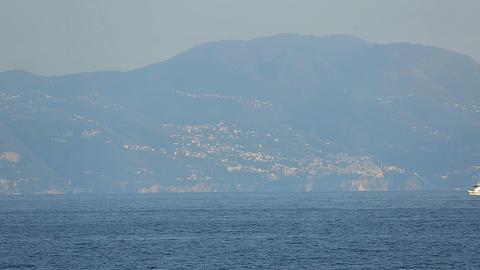 Cruise liner sailing near amazing Vesuvius mount, water transportation, tourism Footage
