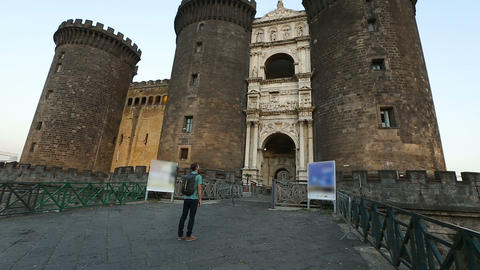 Male tourist walking to beautiful medieval Maschio Angioino castle in Naples Archivo