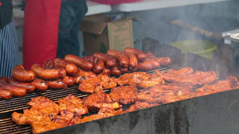 Street vendor cooking grilled food outdoors, unhealthy nutrition, fatty snacks ビデオ