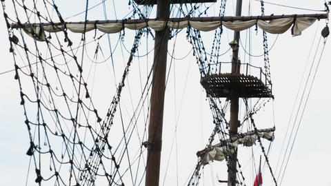 Ancient pirate ship moored in bay of Gdansk attracting tourists, sequence Footage