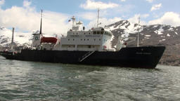 Expedition ship on background of mountains of Falkland Islands in Antarctica Footage