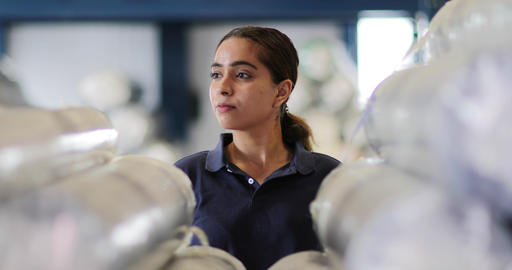 Portrait of female employee in distribution warehouse Footage