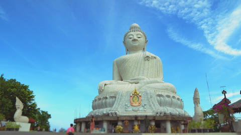 a statue of a large white Buddha. religious asian shrine. temple on the mountain GIF