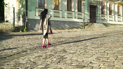 Glamorous woman with pink bag and in trendy shoes walking at stone road in city Footage