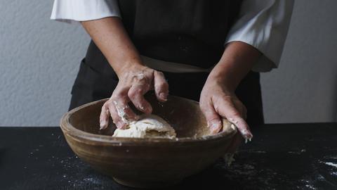 Baker hands kneading dough Footage