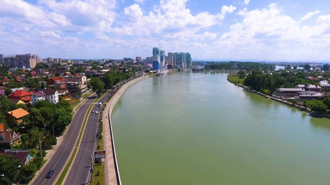 The road to the city on the river Bank. Aerial photography over the Kuban river Live Action