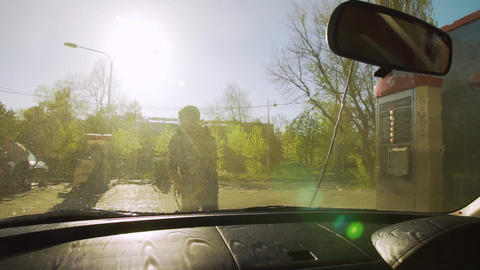 Russia, Krasnodar, April 2018, self-service car Wash. A young man washes the Footage
