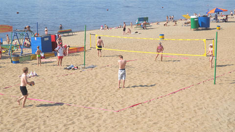 A group of people, men and women playing Beach volleyball Footage
