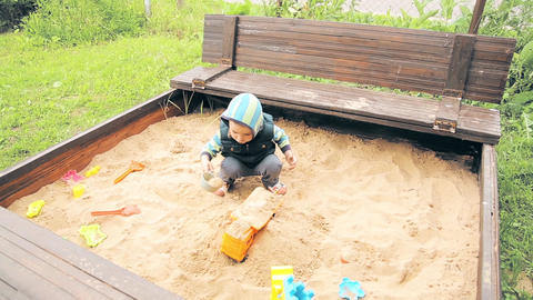 A child in the kindergarten playing in the sandpit Footage