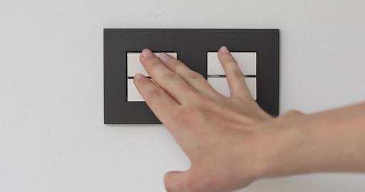 Female hand on light double-switch Footage