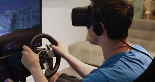 Man uses a car simulator in vr glasses Footage