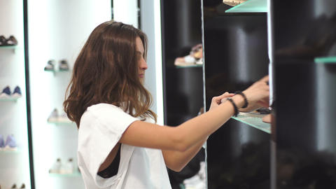 Beautiful Woman at the Store is Choosing Shoes Stock Video Footage