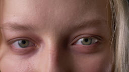 Eyes of young cute blond girl, is watching at camera Footage
