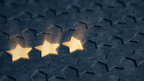Five golden stars appear on the black relief surface Animation