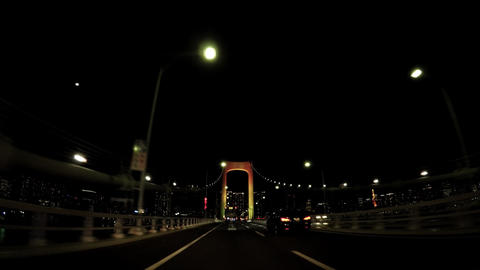 Tokyo city landscape A car window from the Rainbow Bridge at night ビデオ