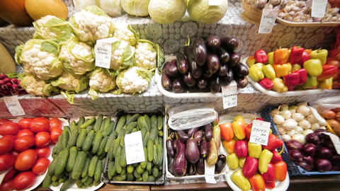 city market with vegetables fruits on stalls buyer makes choice Footage