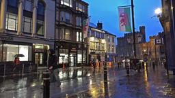 Cardiff / Wales - February 12 2015: People walking through the rain Footage