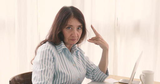 Adult businesswoman showing rock and roll gesture Footage