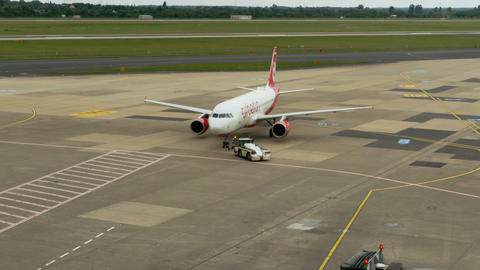 Tow tractor pushing Airbus A320 Footage