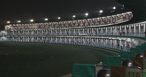Midnight golfers enjoy the practice range at Lotte Kasai Golf