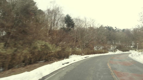 Driver's point of view trailing down the snowy hill of Mt. Fuji Footage