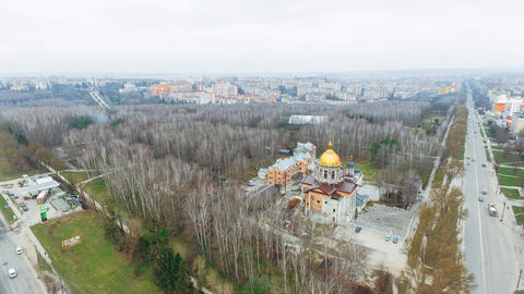 Aerial view of the autumn park, church and roads against the background of multi Photo