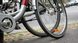 City Traffic Concept: Close-up of Bicycles In Front of A Street, Selected Focus Footage