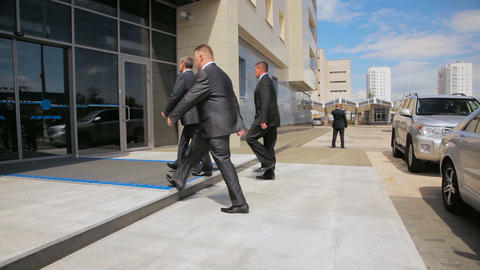 bodyguards accompany protected person to Tatneft office building Live Action