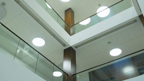interior floors of office building with glass banisters... Stock Video Footage