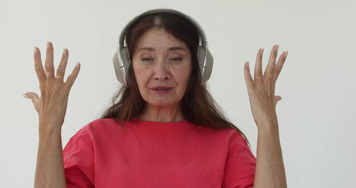 Screaming adult woman does not like what she hears in headphones Footage